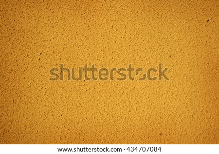 yellow wall shot as background - stock photo