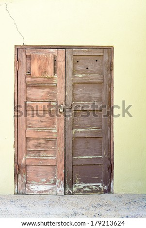 Yellow wall with a pair of wooden doors