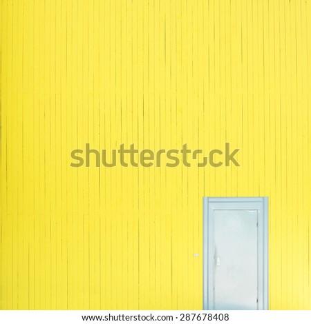 Yellow wall with door - stock photo