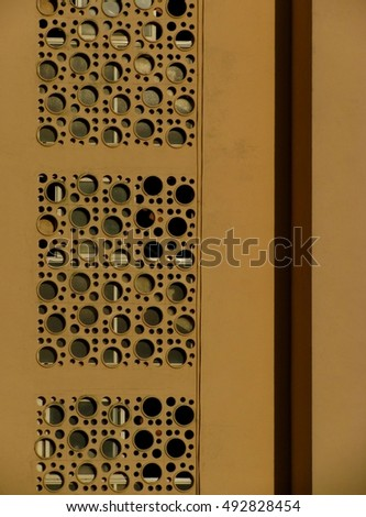 Yellow wall with holes, Spain