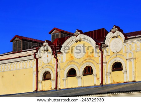 Yellow wall with relief of the vintage building of the end of the nineteenth century - stock photo