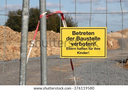 yellow warning sign at German construction site (translation: Do not enter! Parents are liable for their children!)