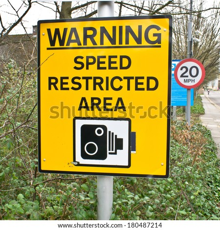 Yellow warning sign for speed cameras on a UK street - stock photo