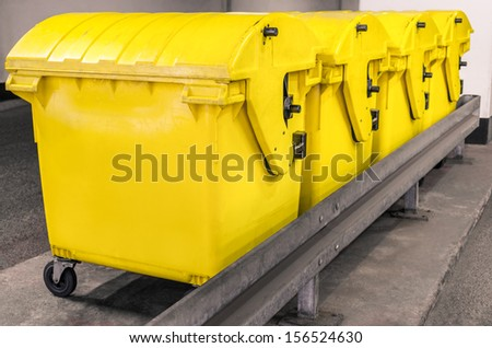 Yellow waste Containers - Recycling bin for special Rubbish - stock photo