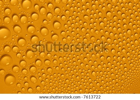 Yellow water drops - stock photo
