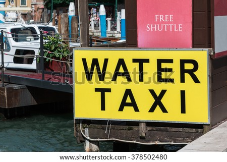 Yellow Water Taxi Sign in Venice, Italy