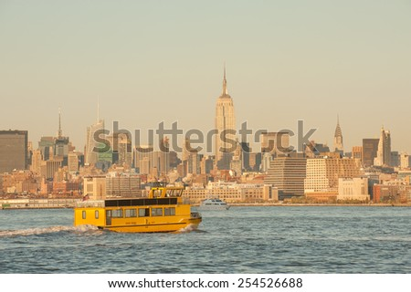 Yellow water taxi to Midtown Manhattan across Hudson river - stock photo