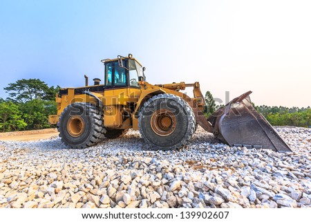 yellow wheel loader at mine site