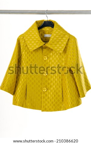 yellow woman clothes on a hanger  - stock photo