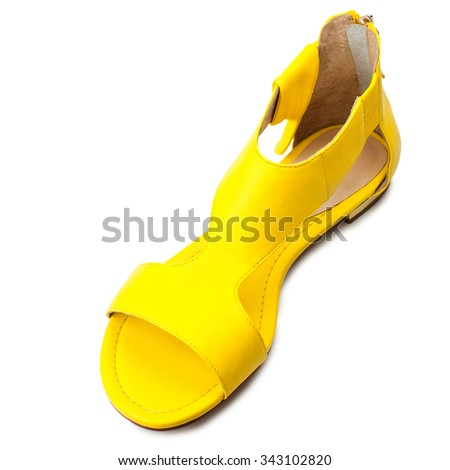 Yellow women sandal isolated on white background.Top view. - stock photo