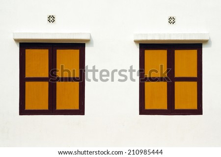 Yellow Wood Windows on white wall