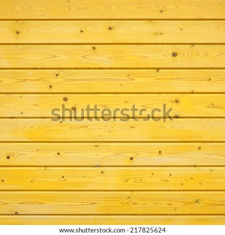 yellow wooden fence made of pine wood - stock photo