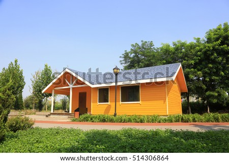 Yellow wooden house in the park