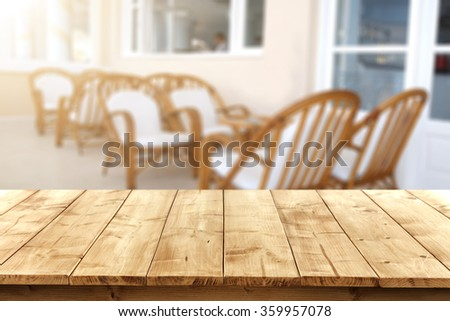 yellow wooden table and chairs and sun light  - stock photo