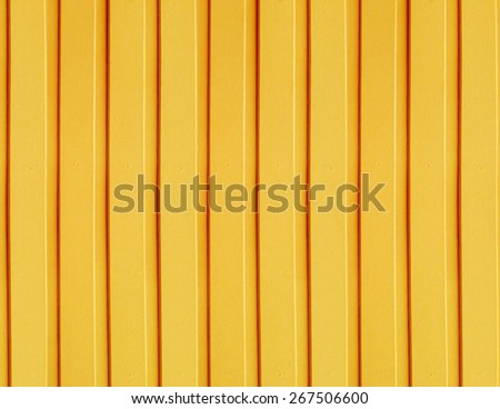 Yellow wooden wall - stock photo
