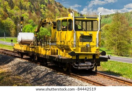 Yellow work train SKL on a historical railway in Frankische Schweiz, Germany - stock photo