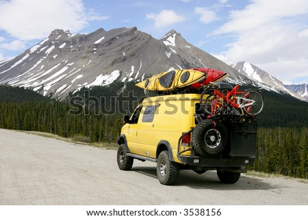 Yellow 4x4 van in Jasper National Park, Canada