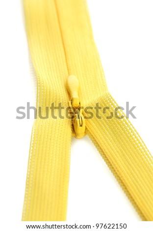 Yellow zipper closeup - stock photo