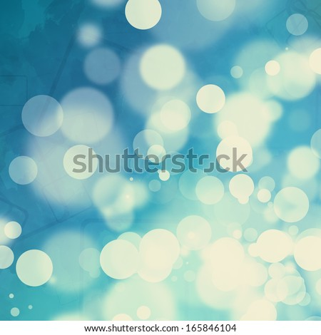 Yellowed bokeh on watercolor blue background - stock photo