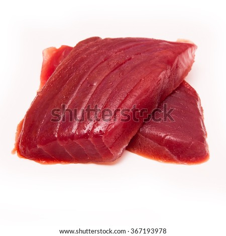 Yellowfin tuna fish steaks (thunnus albacares) isolated on a white studio background. - stock photo