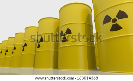 Yellows barrels containing radioactive material - stock photo