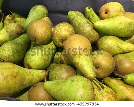 Yellows fresh pears background.