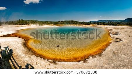 Yellowstone heat pool near Geyser Old Faithful landscape - stock photo