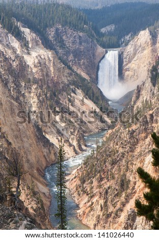 Yellowstone National Park has it's own Grand Canyon noted for picturesque pastel colors. - stock photo