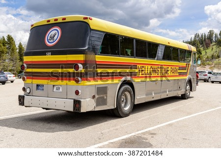 Yellowstone National Park, Wyoming, USA - May 31, 2015: Bus parked at the Mud Volcano Area on the Grand Loops Road in Yellowstone National Park in Wyoming. / Yellowstone Park Tour Bus