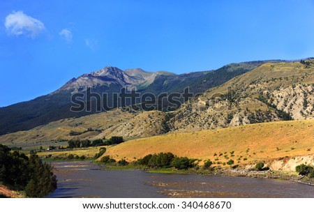 Yellowstone River near Emigrant, Montana runs between two mountain ranges, the Gallatin and the Absaroka mountains. - stock photo