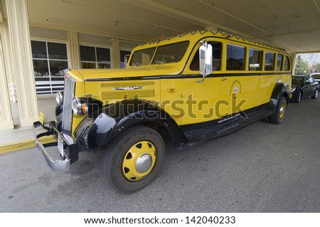 YELLOWSTONE, USA - AUGUST 16: Bus on August 16, 2007 in Yellowstone: front view of an old bus. This bus yellow is one of the symbols of the park and makes daily sightseeing tours in the park.