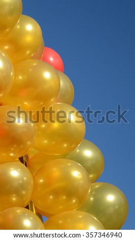 Yelow balloons flying in the sky - stock photo