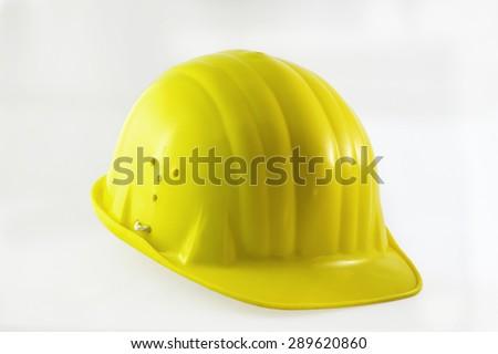 Yelow isolated plastic construction helmet - stock photo