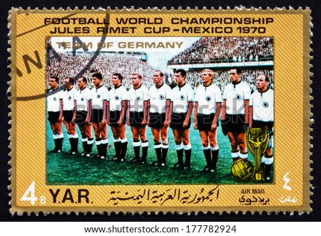YEMEN - CIRCA 1970: a stamp printed in the Yemen Arab Republic shows Team of West Germany, Football World Championship, Mexico, circa 1970 - stock photo