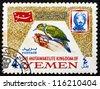 YEMEN - CIRCA 1965: A stamp printed in the Yemen shows Dendrocopus Dorae, Bird, Portrait of Imam Mohammed al-Badr, circa 1965 - stock photo