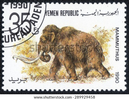 "YEMEN- CIRCA 1990: A stamp printed in Yemen shows a series of images ""Prehistoric Animals"", circa 1990 - stock photo"
