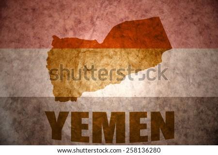 yemen map on a vintage yemeni flag background - stock photo
