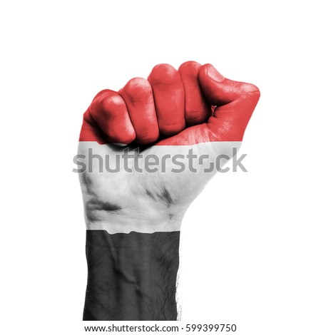 Yemen national flag painted onto a male clenched fist. Strength, Power, Protest concept