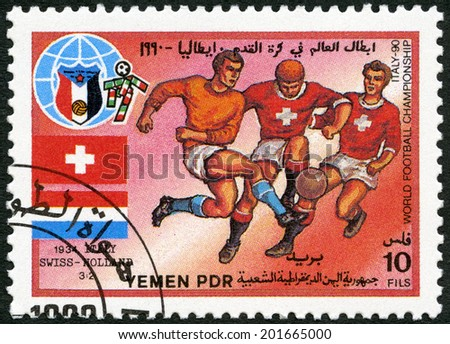 YEMEN PDR - CIRCA 1990: A stamp printed in Yemen PDR shows Soccer game, Switzerland, Holland, 1934, History of World Cup Soccer Championships, circa 1990 - stock photo