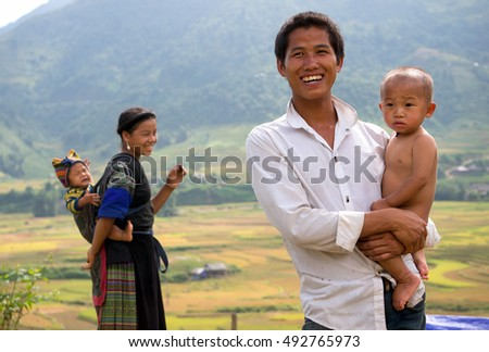 YEN BAI, VIETNAM, September 30, 2016 Hmong families, standing outdoors, area of grain fields, harvests