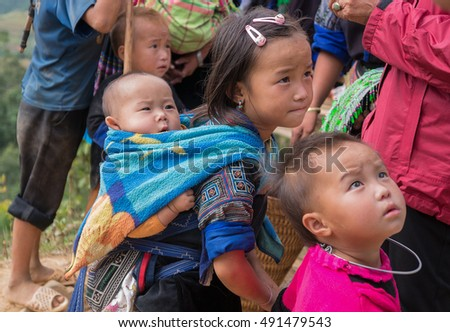 YEN BAI, VIETNAM, September 29, 2016  Hmong group of children, highland Yen Bai, Vietnam, backpacks of children on his back, looking cute