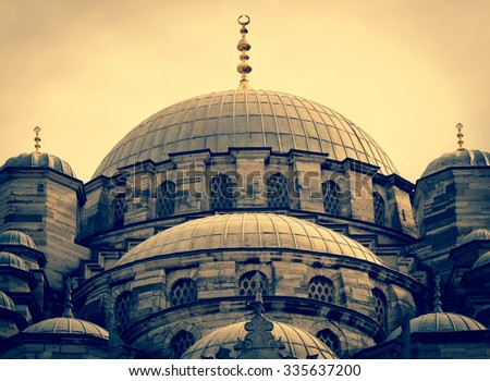 Yeni Cami Mosque at sunset, landmarks of ottoman architectural in Turkey. Muslim architecture at vintage style, old mosque of Istanbul. - stock photo