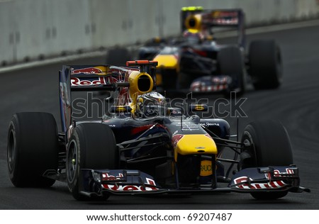 YEONGAM, SOUTH KOREA : German's Red Bull's driver Sebastian Vettel (front) is chased by his teamate, Australian Mark Webber, during the Korean F1 Grand-Prix on October 21, 2010 in Yeongam, South Korea. - stock photo
