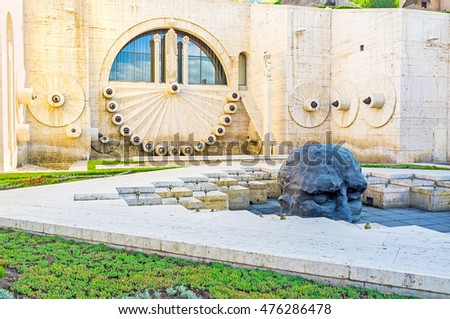 YEREVAN, ARMENIA - MAY 29, 2016: The fountains and pool with the sculpture of man's head in the second level of Cascade, on May 29 in Yerevan.