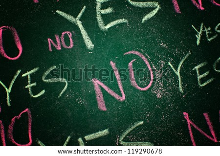 Yes and no concept; words written on green chalkboard - stock photo