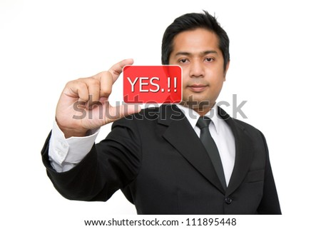 Yes. Business man holding yes button.