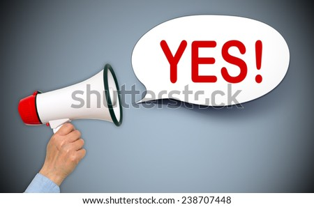 YES ! - Female hand with megaphone and speech bubble - stock photo