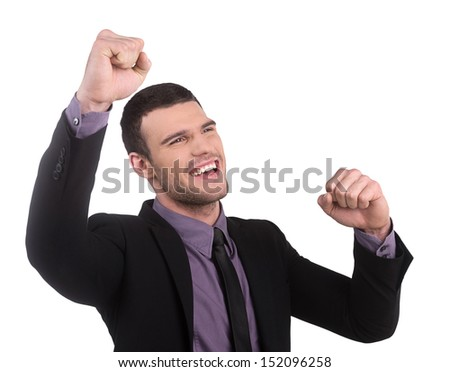 Yes! Happy young businessman gesturing while isolated on white background - stock photo