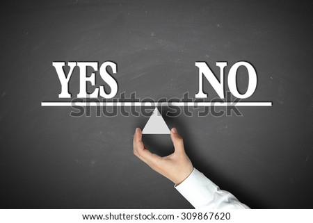 Yes No Balance concept with scale holden by businessman hand against the blackboard background. - stock photo