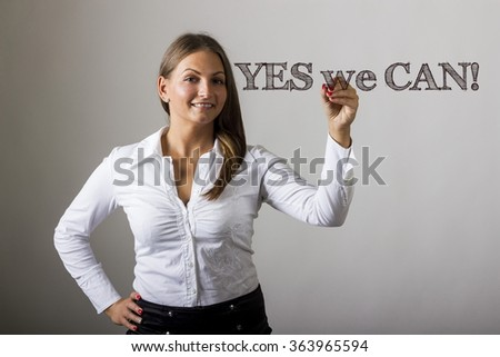 YES we CAN! - Beautiful girl writing on transparent surface - horizontal image